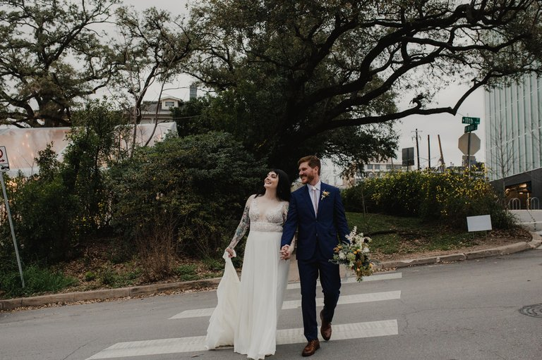bride and groom crossing a downtown austin street