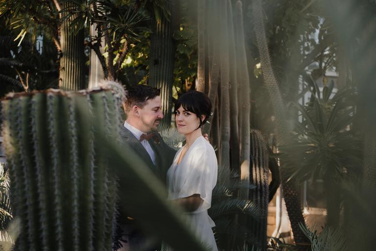 boho bride and groom in a cactus garden