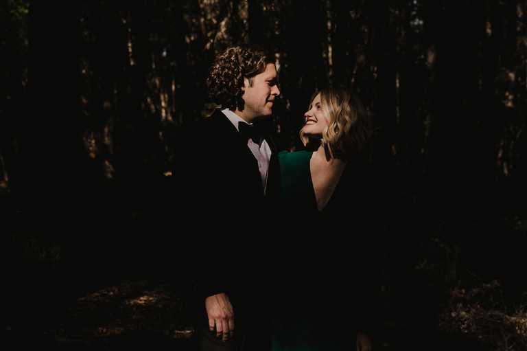bride and groom in the sunlight of redwood forest