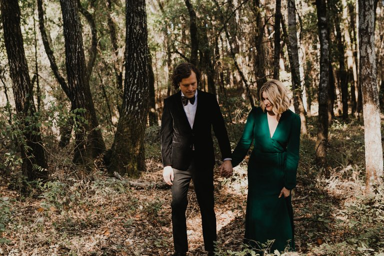 bride and groom walking through Henry Cowell Redwoods State Park