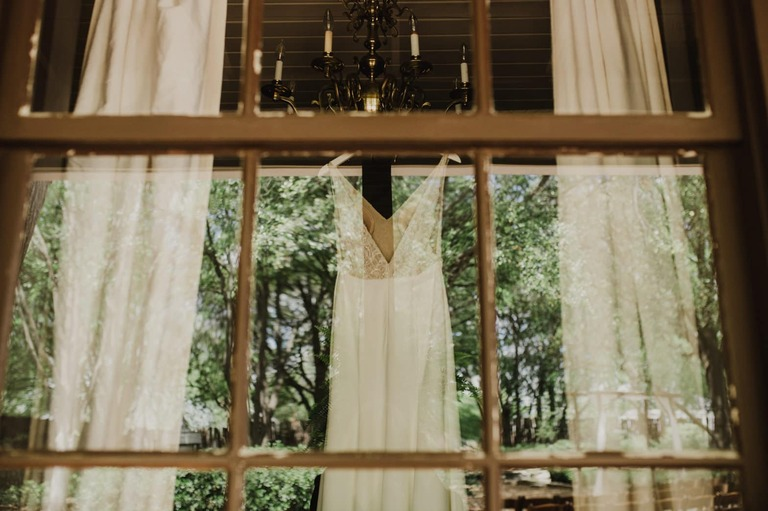 hoffman haus window with sarah seven wedding gown hanging